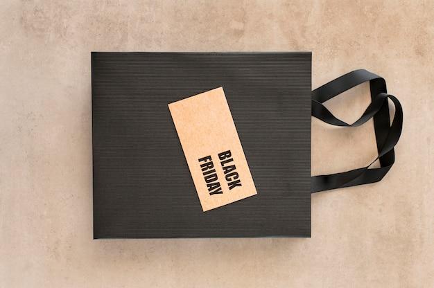Black friday sale label on shopping bag Free Photo