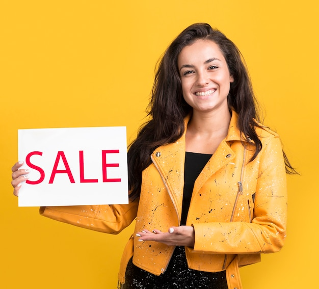 Black friday sale model holding a sale banner Free Photo
