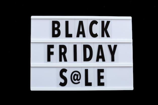 Black friday sale text on lightbox on black background Premium Photo