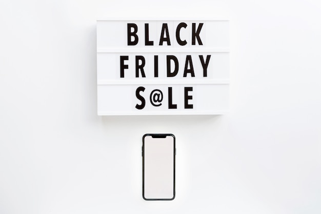 Black friday sale text on lightbox and mobile phone on white background Premium Photo