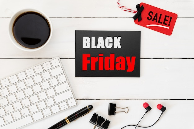 Black friday sale text on a red and black tag Premium Photo