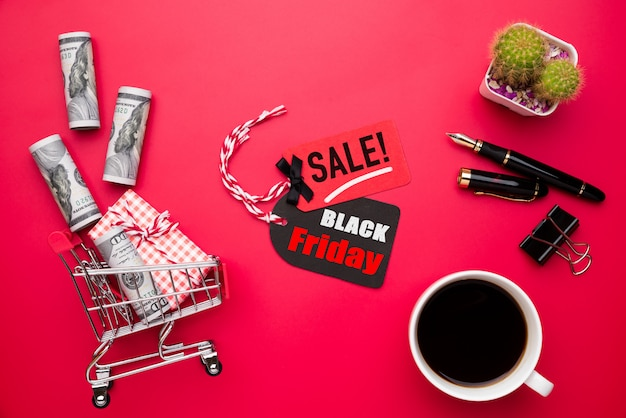 Black friday sale text on tag with roll of usa banknotes Premium Photo