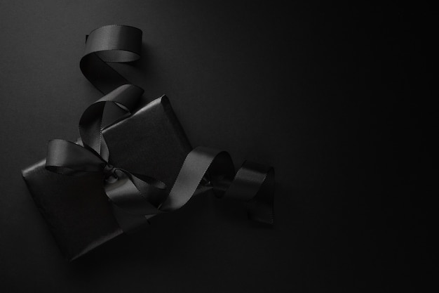 Black gift on dark Free Photo