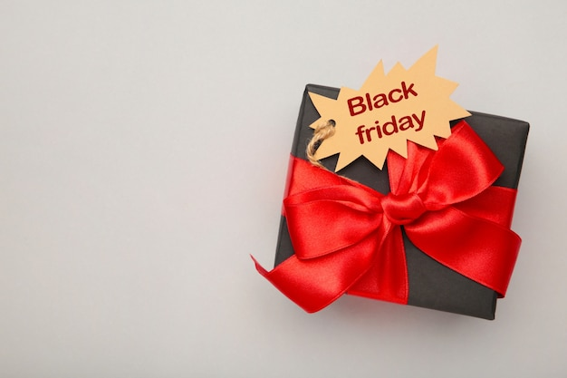 Black gift with sale tag top view Premium Photo