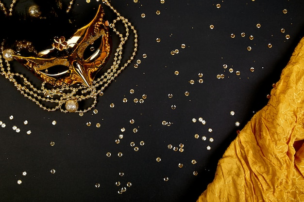 Black and gold carnival mask. top view Premium Photo