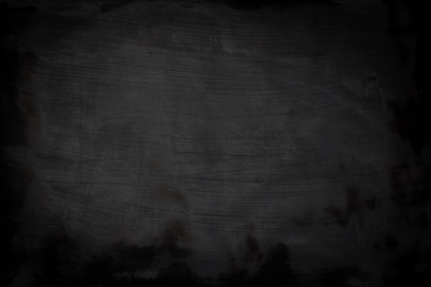 Black grunge texture with copyspace. abstract chalk rubbed out on blackboard. Premium Photo