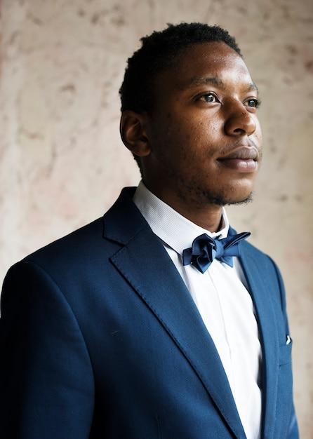 Black guy groom nervous portrait Premium Photo