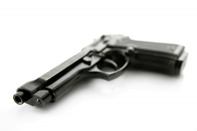 Black hand gun pistol over Premium Photo