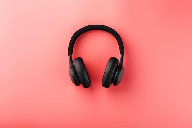 Black headphones on pink Premium Photo