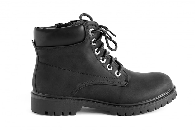 Black heavy duty unisex boots isolated on white , shoes for autumn winter season Premium Photo