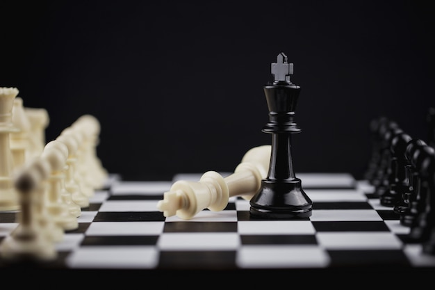 Black king in chess game with concept for company strategy. Premium Photo