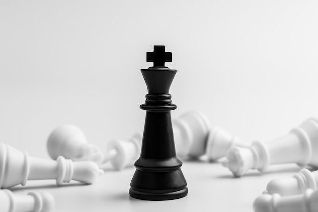 Black king chess stand alone in among the losers Premium Photo