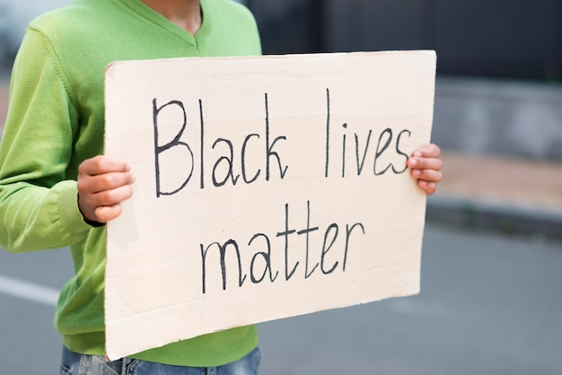 Black lives matter concept quote on cardboard Free Photo