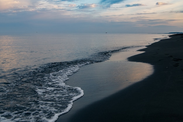 Black magnetic sand beach of black sea in ureki, georgia. Premium Photo