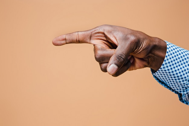 Black male hand point finger. hand gestures - man pointing on virtual object Free Photo