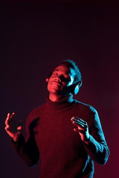 Black man posing with headphones Free Photo