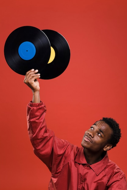 Black man posing with vinyls Free Photo