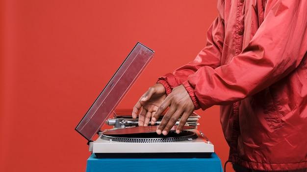 Black man posing with vinyls Free Photo
