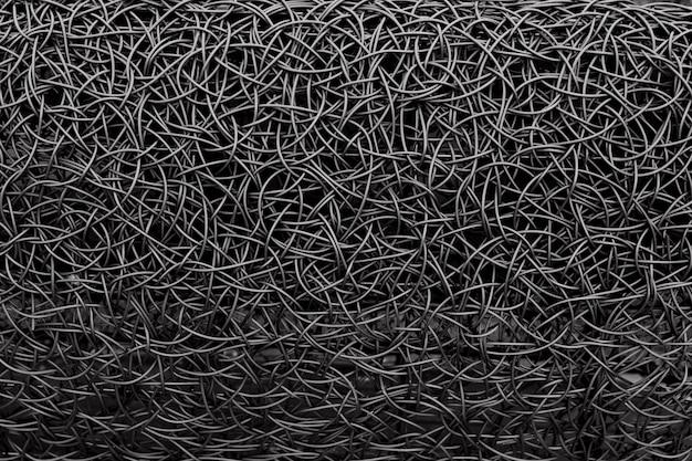 Black messy metal wire braiding. steel textured background. Premium Photo