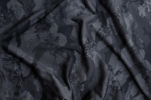 Black military camouflage fabric Premium Photo