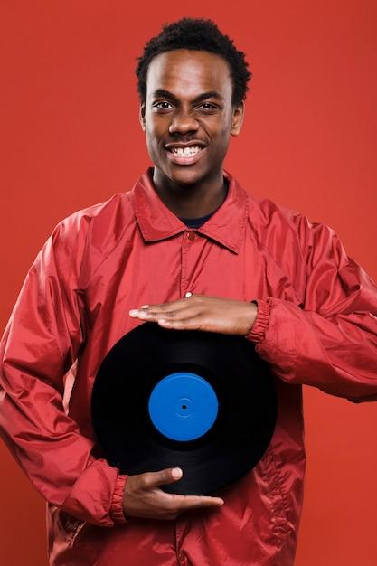 Black model posing with vinyls Free Photo