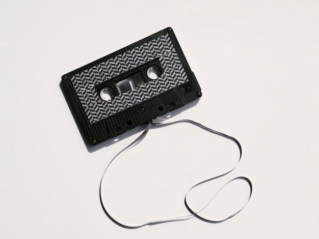 Black modern broken cassette tape Free Photo