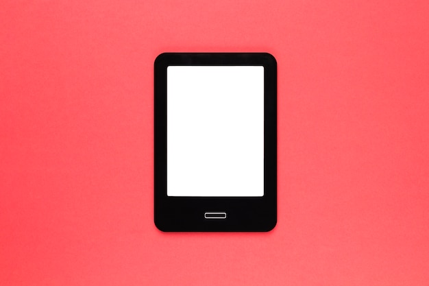Black modern tablet on pink surface Free Photo