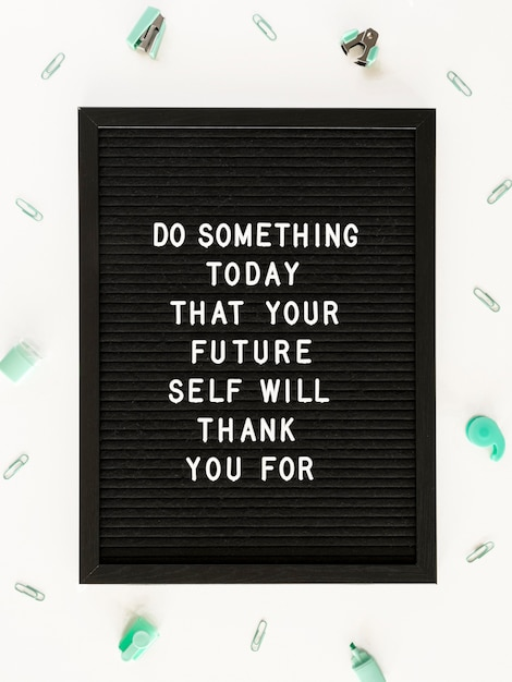 Black motivational text board flat lay Free Photo