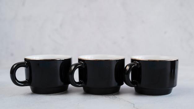 Black mugs for coffee Free Photo