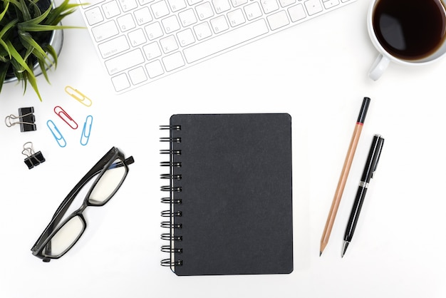 Black notebook on white desk table background with copy space Free Photo