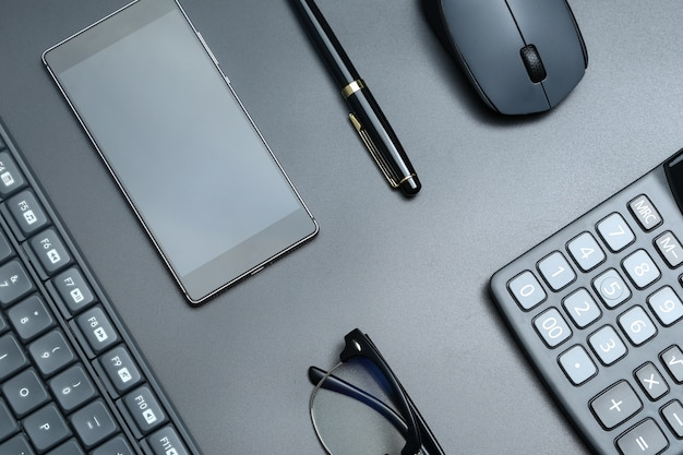 Black office business equipment on black background Free Photo