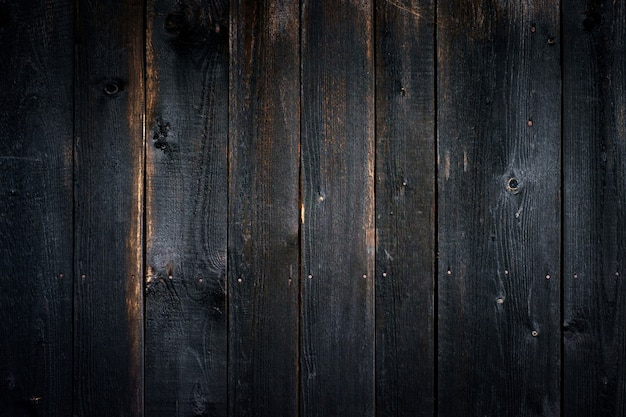Black old wooden background with vertical boards Premium Photo