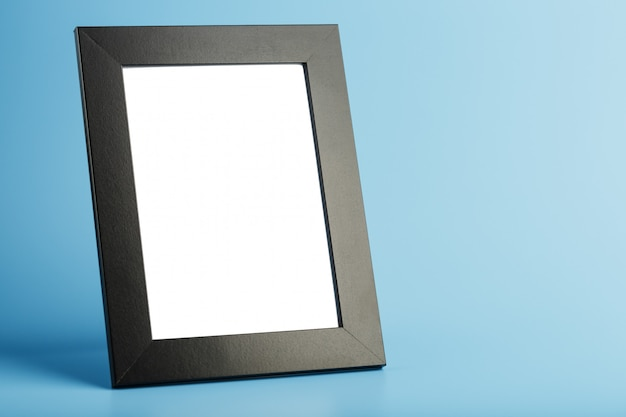 Black photo frame with empty space on a blue background. Premium Photo