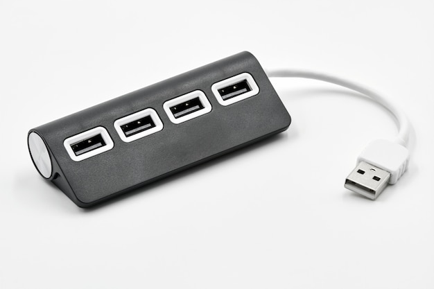 Black portable usb hub for four connections on a white background. bus povered. Premium Photo