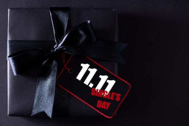 Black present with ribbon for single's shopping day Premium Photo