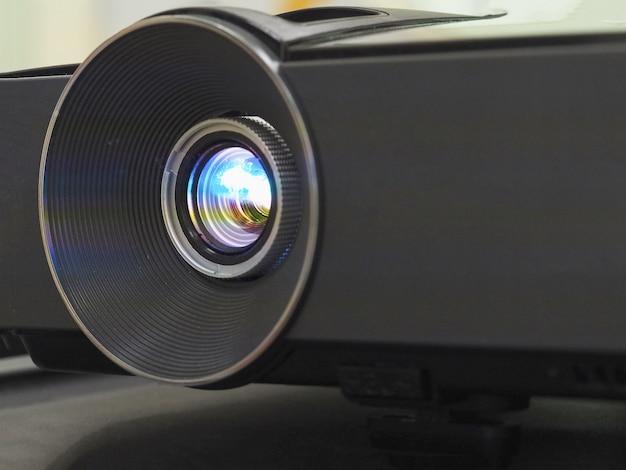 Black projector on black table, close up. Premium Photo