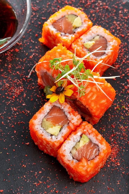 Black rectangle plate with sushi, isolated on white Premium Photo