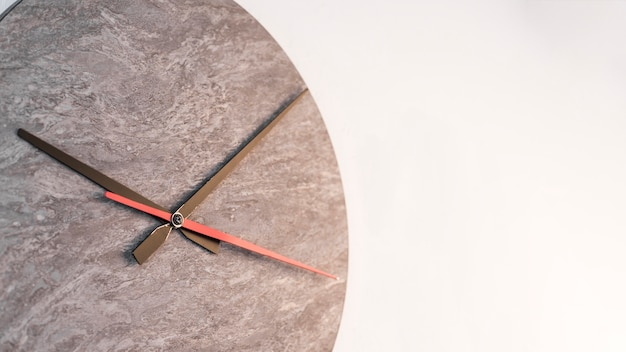 Black and red clock hands against white background Free Photo