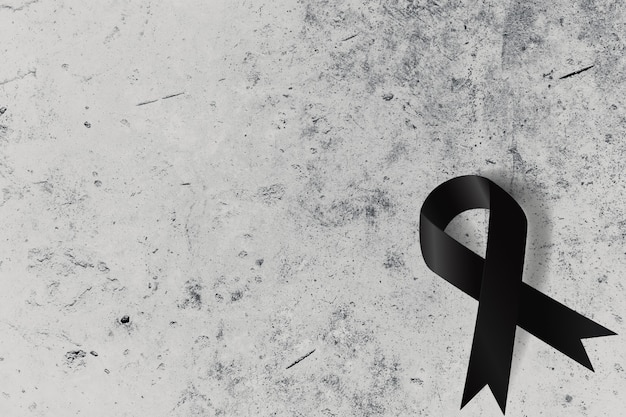 Black ribbon on concrete wall with space for text Premium Photo