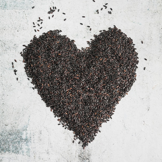 Black rice in form of heart Free Photo