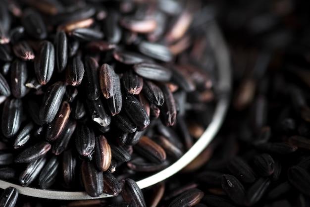 Black rice in metallic bowl Free Photo