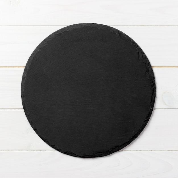 Black round plate Premium Photo