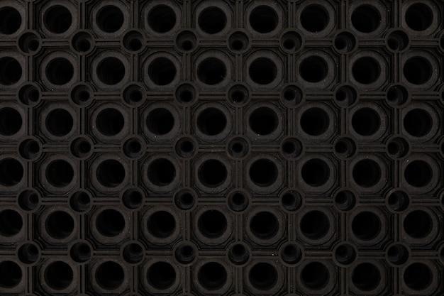 검은 고무 바닥 매트 클로즈업. 프리미엄 사진