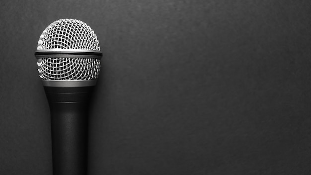 Black and silver microphone on a black background Free Photo
