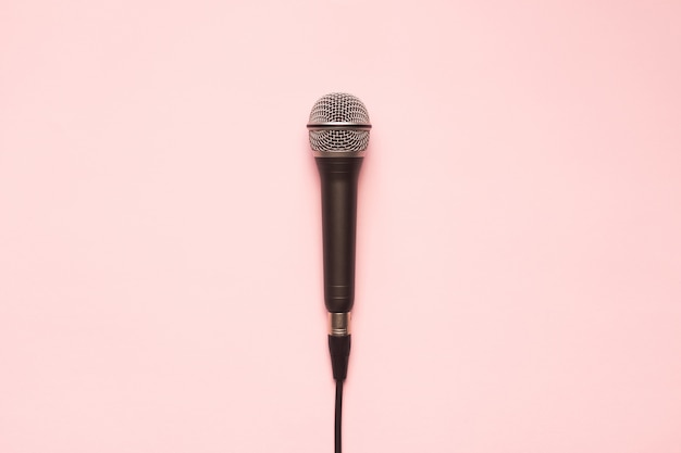 Black and silver microphone on a pink background Free Photo