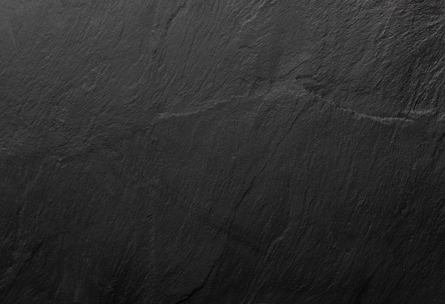 Black slate texture in which the grain of the mineral can be seen. empty table for cheeses and other snacks. copyspace (copy space). Premium Photo
