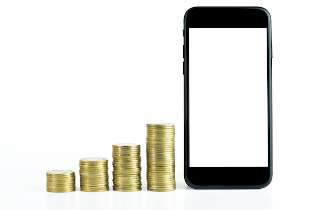 Black smart phone with black screen and stack of gold coins Premium Photo