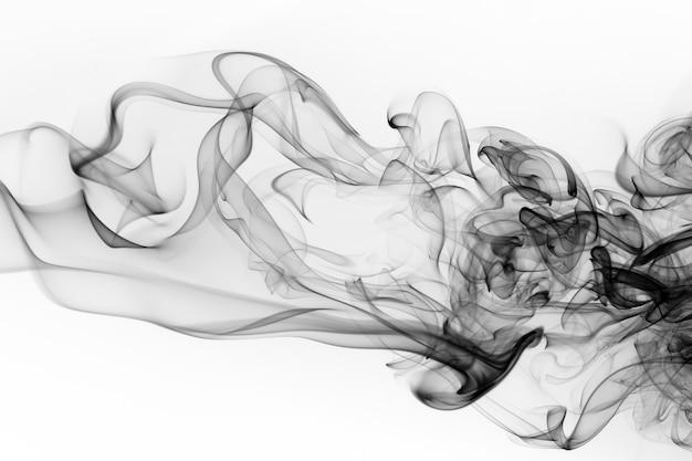 Черный дым аннотация на белом фоне, огонь Premium Фотографии
