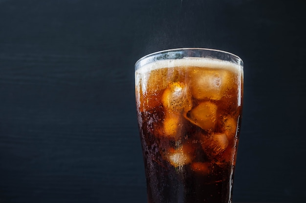 Black soft drink refreshing and cola drink on table Premium Photo
