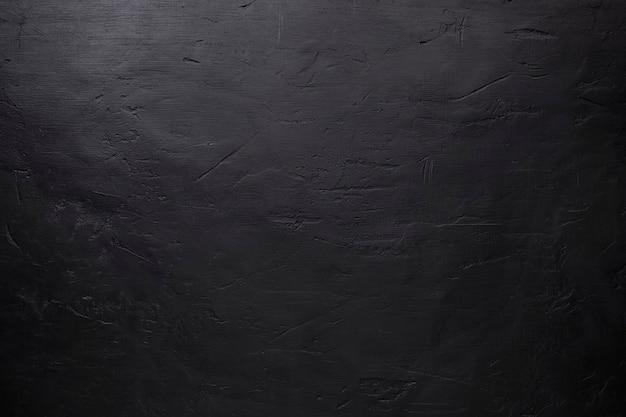 긁힘과 함몰이있는 검은 돌 배경 프리미엄 사진